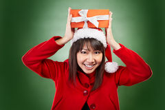 Christmas girl holding gift Royalty Free Stock Images