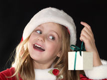 Christmas girl holding gift royalty free stock photo