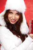 Christmas girl  holding a gift in packing Stock Photos