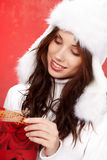 Christmas girl  holding a gift in packing Stock Photography