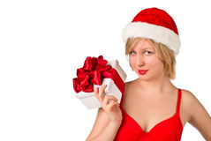 Christmas girl holding gift wearing Santa hat Stock Image