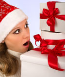 Christmas girl holding many presents. With red ribbons royalty free stock photos