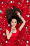 Christmas Girl Holding a Mistletoe and Blowing Kisses. Beautiful flirty woman in Christmas fantasy portrait Stock Images