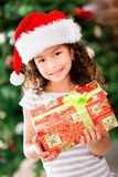 Christmas girl holding a present Royalty Free Stock Photos