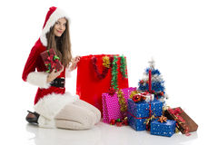 Christmas girl holding present Stock Photo