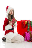 Christmas girl holding present Royalty Free Stock Image