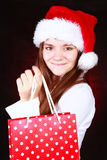 Christmas girl holding present bags Stock Photos
