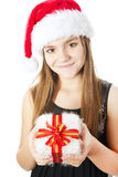 Christmas girl holding present isolated over white Stock Photos