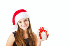 Christmas girl holding present isolated over white Royalty Free Stock Image