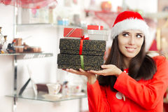 Christmas Girl Holding Presents in Gift Shop Stock Photography