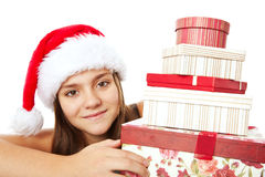 Christmas girl holding presents over white Stock Images