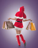 Christmas girl holding shopping bags Royalty Free Stock Images