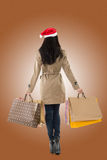 Christmas girl holding shopping bags Stock Images