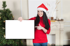Christmas girl holding a sign Royalty Free Stock Photos