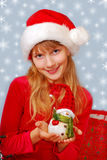Christmas girl holding snowman figurine Royalty Free Stock Images