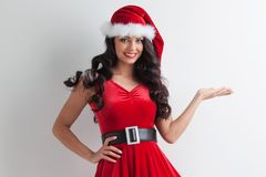 Christmas girl holding something Royalty Free Stock Images