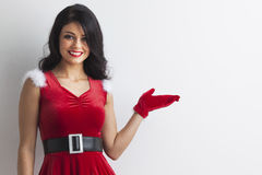 Christmas girl holding something Royalty Free Stock Photography