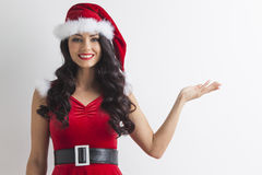 Christmas girl holding something Royalty Free Stock Photo