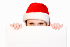 Christmas girl holding up a white sign Royalty Free Stock Image