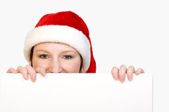 Christmas girl holding up a white sign Royalty Free Stock Photo