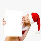 Christmas girl holding up a white sign for copyspa Stock Image