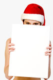 Christmas girl holding up a white sign Royalty Free Stock Photography