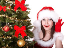 Christmas Girl In Hat With Hand Near Ear Listen. Royalty Free Stock Photos
