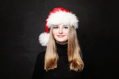 Christmas Girl In Santa Hat Smiling Stock Images