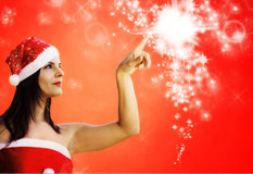 Christmas girl indicates sparkling stars Royalty Free Stock Photography