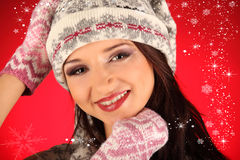 Christmas girl with knitted gloves Royalty Free Stock Images
