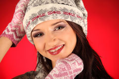 Christmas girl with knitted gloves Stock Image