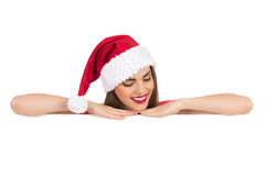 Christmas girl lean on a banner Stock Photo