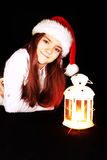 Christmas girl with lighting lantern over dark Royalty Free Stock Image