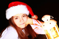 Christmas girl with lighting lantern over dark Royalty Free Stock Photography