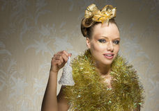 Christmas girl with little bell Royalty Free Stock Photos
