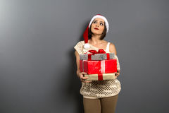 Christmas girl look up empty copy space hold gift box present, y Stock Photography