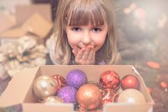 Christmas girl looking at decorations portrait Stock Photo