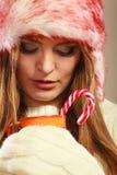 Christmas girl with mug and cane. royalty free stock photography