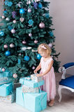 Christmas. Girl with a New Year gift royalty free stock photo