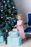 Christmas. Girl with a New Year gift stock photos