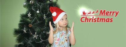 Christmas. girl in a New Year& x27;s cap royalty free stock photos