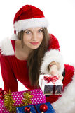 Christmas girl offering gift Stock Image
