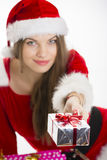 Christmas girl offering gift Stock Photos