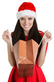Christmas Girl with Open Shopping Bag. Young woman in Christmas costume on white background Royalty Free Stock Images