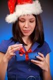 Christmas girl opening gift Stock Photos