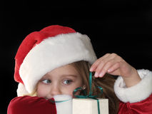 Christmas girl opening gift Stock Photos