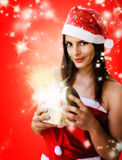 Christmas girl opening sparkling  gift box Royalty Free Stock Images