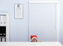 Christmas girl at ophthalmologist Royalty Free Stock Photo