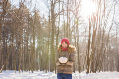 Christmas girl outdoor portrait. Winter woman blowing snow in a park Royalty Free Stock Photos
