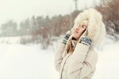 Christmas girl outdoor portrait. Woman in winter clothes Stock Photos
